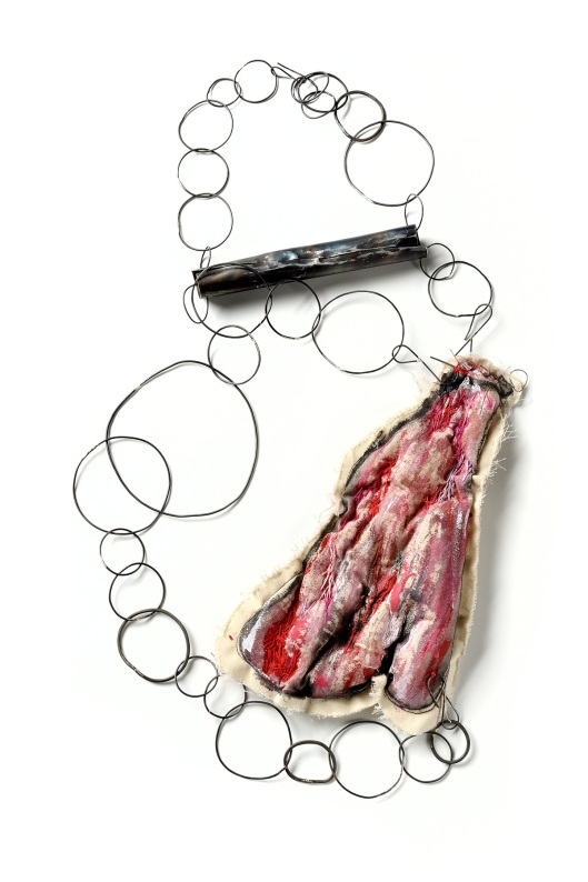Maru Lopez - Tanta carne y yo sin dientes, 2011. Necklace. Fabric, acrylic, iron. Photo courtesy of the artist.