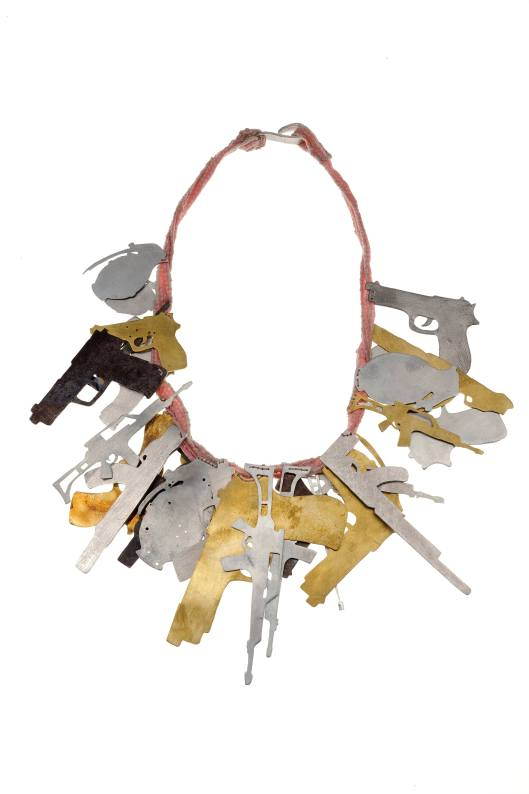 "Malaika Najem - ""A long way gone"". Necklace. Pink fabric, aluminium, iron, shibuichi, brass."