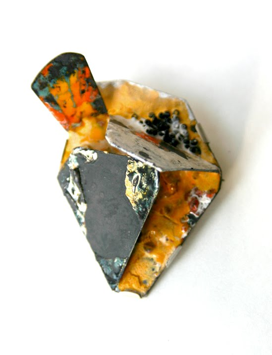 Inari Kiuru - Brooch. Steel, enamel, silver. Photo from http://inarikiuru.blogspot.com