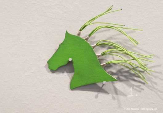 "Anna Pervolaraki - ""Prasino Alogo"" (green horse, 2012). Brooch. Silver 925, silver thread, paint. Photo by Eleni Roumpou"