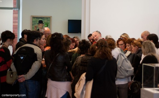 Akis Goumas talking to the visitors of his exhibition at the Benaki Museum. Photograph by Eleni Roumpou
