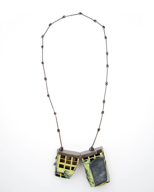 "Demitra Thomloudis - ""Perforated Cleft Slab"" (2013). Necklace. Cement, plywood, nickel silver, silver solder, pigment. Picture courtesy of the artist."