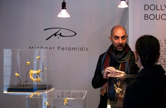Michael Pelamidis at his stand. Photo by Eleni Roumpou