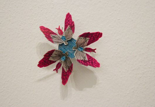 Mei-Fang Chiang - Brooch (2013). Anodized aluminium, ink, paint, stainless steel wire, toner. Photo by Eleni Roumpou